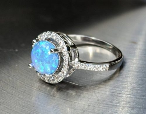 round cut blue fire opal ring with AAA CZ Jpeg.