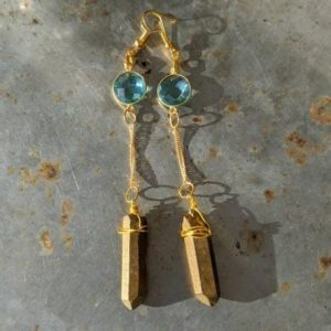gold titanium crystal point earrings jpeg